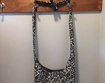 Black & White Reversible Cross Body Bag with Adjustable Strap and Pocket.