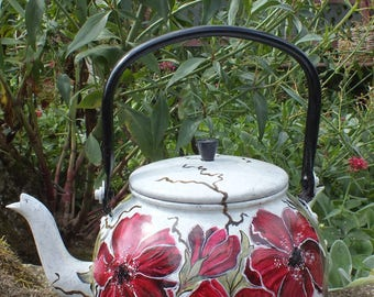 Vintage: beautiful flowers painted on a retro kettle