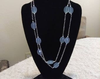 Necklace, sterling silver with blue lace faceted stones