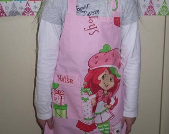 Child apron embroidered with name on the cover