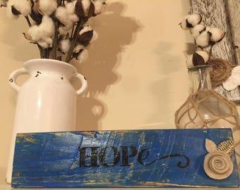 Dark blue rustic pallet wood Hope in black