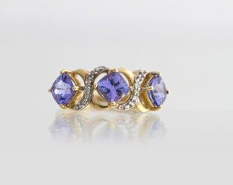 Deep Blue Tanzanite and Diamonds ring