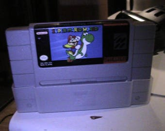 super mario world fore the super nintendo with dust cover