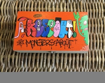 Hand painted Graffiti style wooden box with segmented interior. 'keep out..monsters about'