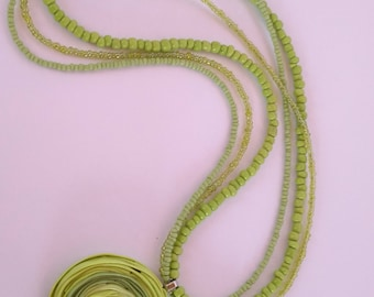 Green polymer clay pendant with beaded necklace