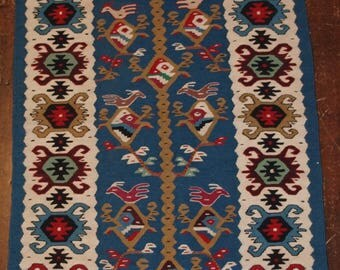 Old Turkish kilim of small size with an excellent blue and sweet design with birds, circa 1950
