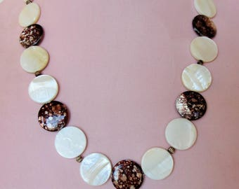 Shell necklace with petrified wood beads