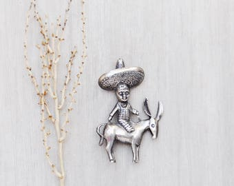 Vintage Man on a Burro Brooch - sterling silver boy figure in big sombrero hat riding a donkey - figural pin