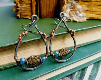 Hammered steel, blue green, faceted, fire polished, Czech glass rondelle, copper coin, geometric design,wire wrapped earrings.
