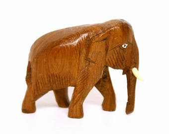 Detailed Carved Wooden Elephant Figurine with Tusks