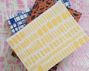 A5 sized hardback notebooks and sketchbooks in screen printed fabric by Lucie Summers. Great stocking filler!