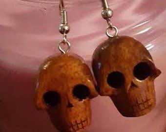 Hand carved Hawaiian Koa skull earrings