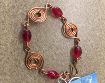 Copper Metal Swirls with Red Beads Bracelet