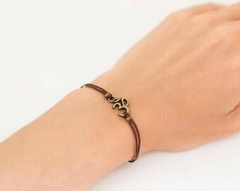 OM bracelet, women bracelet with bronze Ohm charm, Hindu symbol, brown cord, gift for her, yoga bracelet, lucky charm, chakra jewelry