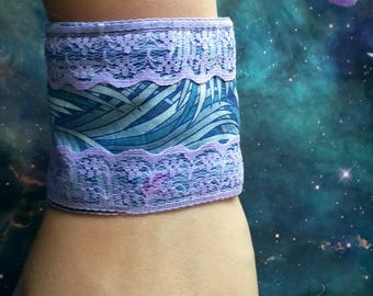 Pastel purple and turquoise cosmic lace cuffs