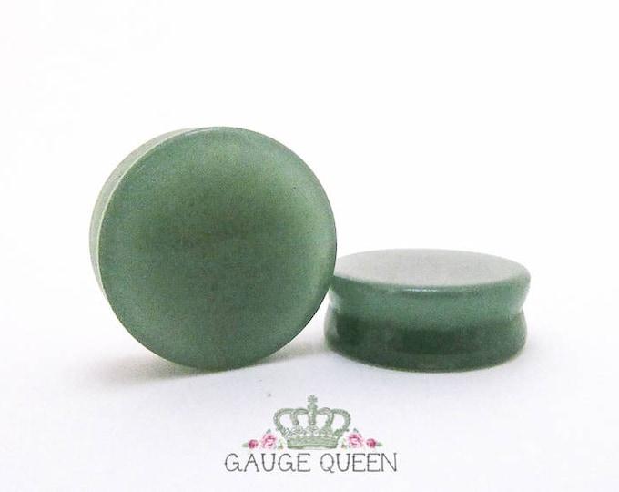 "Jade Stone Plugs / Gauges. 4g /5mm, 2g /6.5mm, 0g /8mm, 00g /10mm, 1/2"" /12.5mm, 9/16"" /14mm, 5/8"" /16mm, 3/4"" /19mm, 7/8"" /22mm, 1"" /25mm"