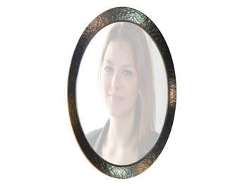 Miroir ovale en fer forgé