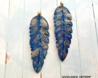 2 Blue feather pendants - Blue feathers with gold highlights - Patina charms - Boho charms - Hand painted feathers - Jewellery making - UK