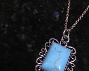 Rectangle turquoise Stone in a Figaro frame-on a silver chain