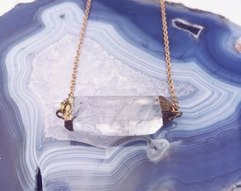 Horizontal Gold Quartz Stone Hanging From A Gold-plated Necklace