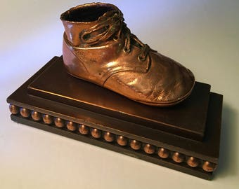 Vintage bronzed baby shoe on fancy base