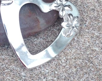 Unique large sterling silver heart with flowers.