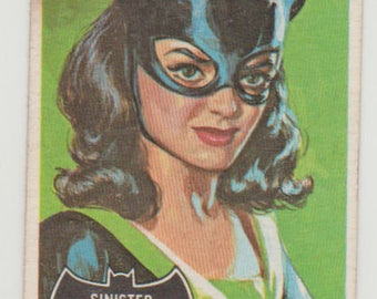 """1966 Topps Batman Trading Card (Black Bat). #27 """"Sinister Smile"""" featuring Catwoman. VG-EX 4. Topps Company Inc, DC Comics"""