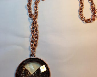 copper pendant with butterfly design