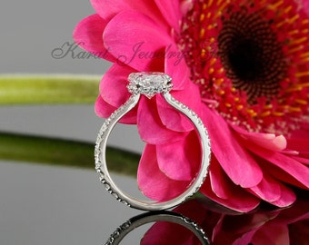 9x7mm Oval Forever One Moissanite and Solitaire Engagement Ring with Diamonds in 14K White Gold ( avail. rose, yellow gold and platinum)