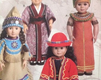 Ethnic clothing for dolls, Japanese robe, Egyptian dress and hat, South American outfit, American Indian dress and hat, McCall's doll dress