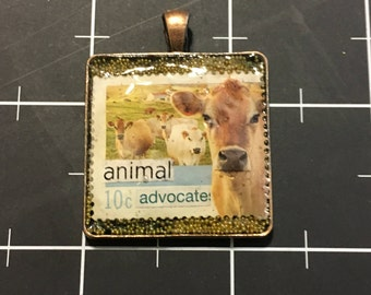 Animal Advocate, Altered Postage Stamp Pendant, 50% goes to the current focus charity