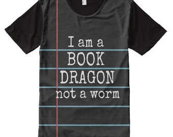 """Notebook Paper Graphic with """"I am a BOOK DRAGON not a worm"""" printed in white chalk on a black chalkboard. Classic back to school fashion."""