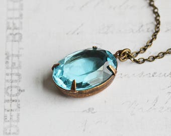 Aqua Blue Oval Rhinestone Pendant Necklace on Antiqued Brass Chain (Vintage Glass)