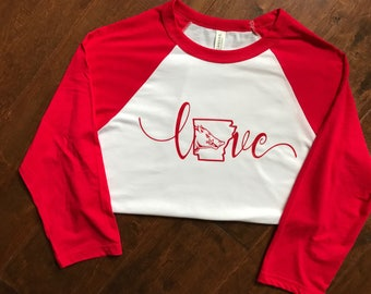 "Arkansas Razorbacks ""Love"" on a raglan shirt."