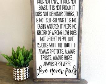 Love never fails | framed wood sign