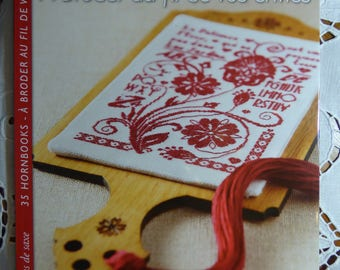 Book 35 Hornbooks has embroidery over desires of Isabelle Haccourt Vautier Saxony edition