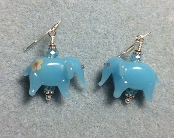 Opaque turquoise lampwork elephant bead earrings adorned with turquoise Chinese crystal beads.