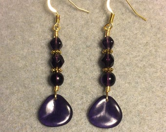 Dark purple Czech glass rose petal dangle earrings adorned with dark purple Czech glass beads.