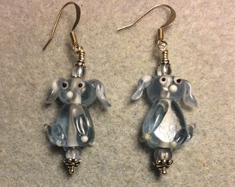 Translucent light blue floppy eared lampwork puppy dog bead earrings adorned with light blue Czech glass beads.