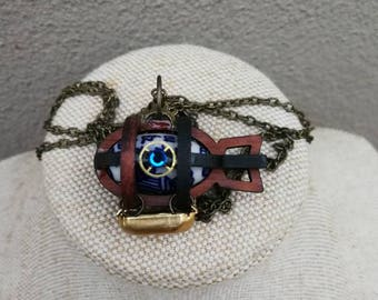 Delicate Steampunk airship zeppelin made of wood, Swarovski Crystal, watch parts and beautiful porcelain bead.  DesignBy Alchemy Alice