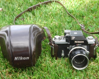 vintage nikon f 35mm camera,with 55mm f3.5 micro nikkor lens.