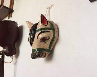 Small wooden horse head