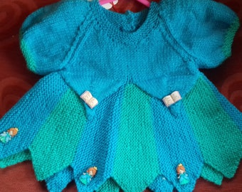 Hand knitted dress to fit a baby girl aged 0-3 months old