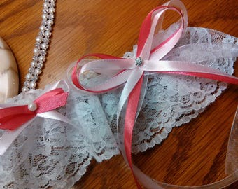 Wide white lace and pink bows, fuchsia wedding garter