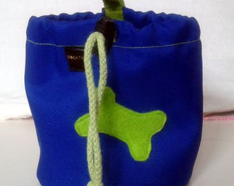 Royal blue dog treat pouch with a bone motif