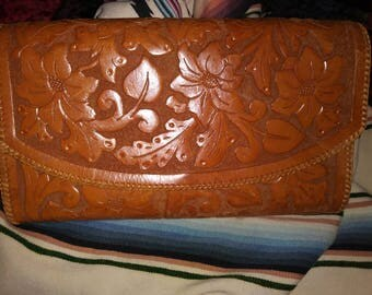 Large 1940s tooled leather clutch.