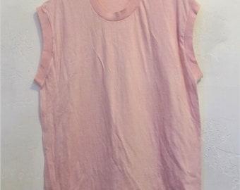A Vintage 80's era,Soft Sleeveless PINK t shirt.M/L