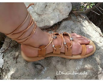 Greek handmade leather sandals with silver charms.