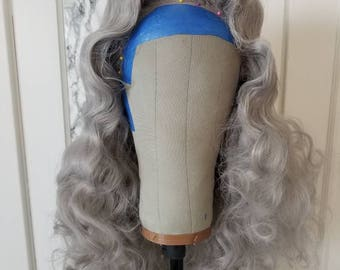 Middle-Part Wig with defined waves and curls