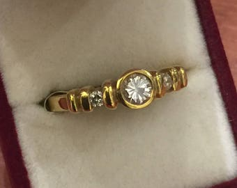 Three-Stone Diamond Ring in 18K Yellow Gold. Italy, circa 1980's.